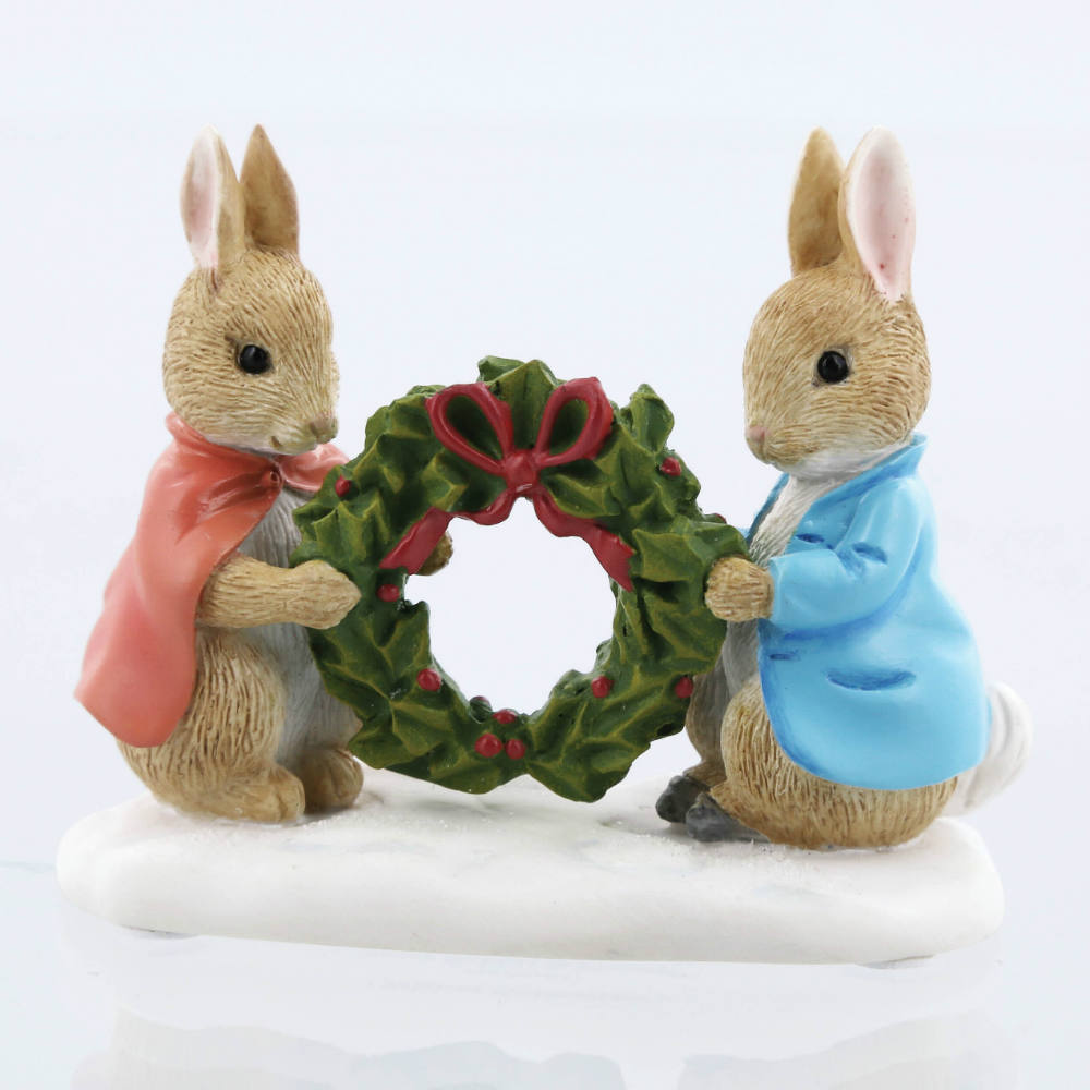 | Peter and Flopsy holding wreath a28966